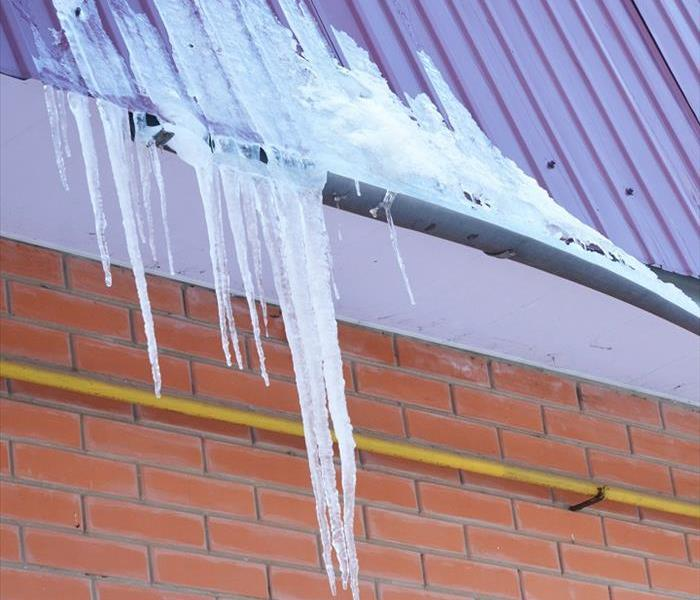 Icicles on roof; ice dam formed